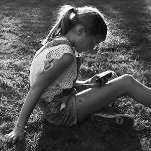 Aliena sitting on the grass